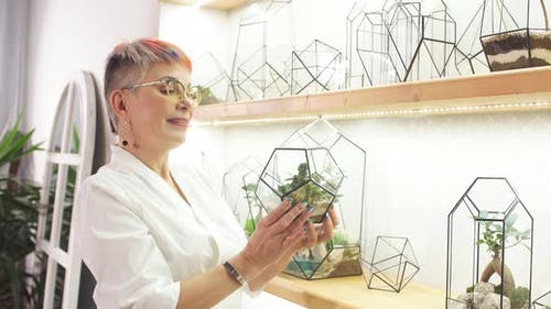 Careful Female Florist Take Care of Plants