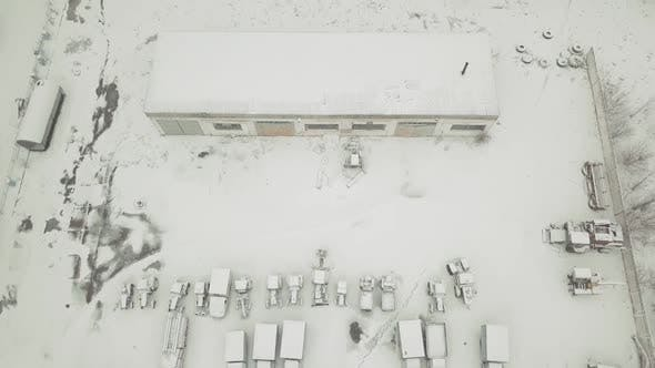 View From a Drone To an Abandoned Snowcovered Vehicle Fleet of Technical Vehicles