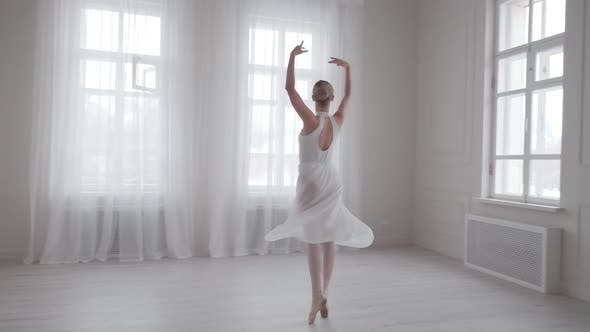 Thumbnail for Graceful Ballerina Dancing and Tiptoeing in Pointe Shoes in a Bright Dance Class