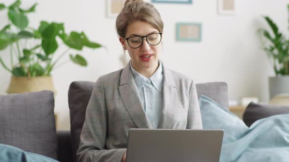 Thumbnail for Businesswoman Using Laptop and Having Remote Meeting at Home