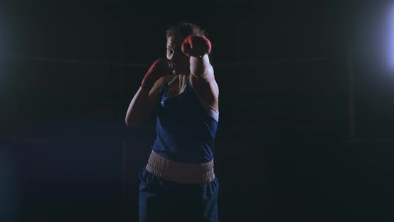 Thumbnail for Professional Beautiful Female Boxer Otbryvatyvat Blows Conducting a Fight with a Shadow in a Dark