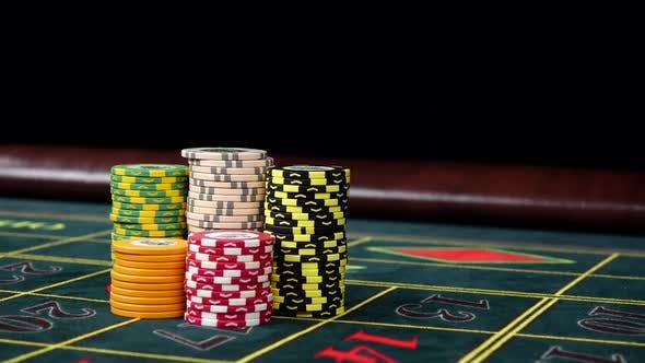 Thumbnail for Poker Chips on a Gaming Table with Winning Chip, Black