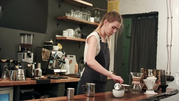 Thumbnail for Barista Pouring Coffee and Milk To a Cup in the Coffee Shop