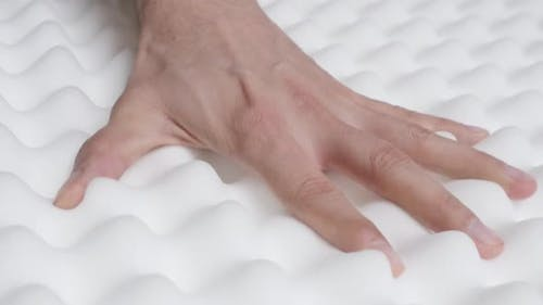 Inspection of memory foam peak and valley mattress  slow motion 1080p HD video - Orthopedic exaggera