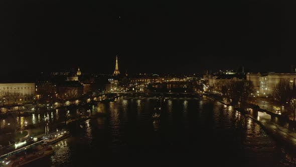 Thumbnail for AERIAL: View Over Seine River at Night in Paris, France with View on Eiffel Tower, Tour Eiffel and