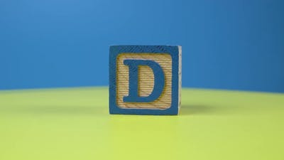 "Close up shot letter ""D"" alphabet wooden block"
