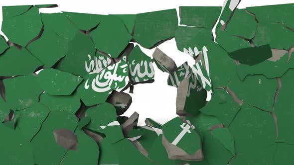 Destroying Wall with Painted Flag of Saudi Arabia