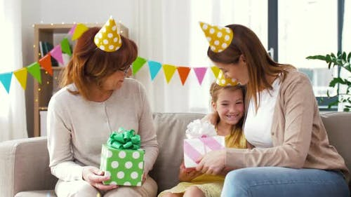 Family Greeting Girl with Birthday at Home Party