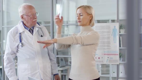 Senior Neurologist Testing Proprioception of Woman