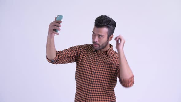 Thumbnail for Happy Bearded Persian Hipster Man Taking Selfie with Phone
