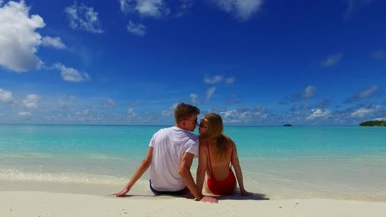 Thumbnail for Fun people in love dating on vacation have fun on beach on sunny white sandy background