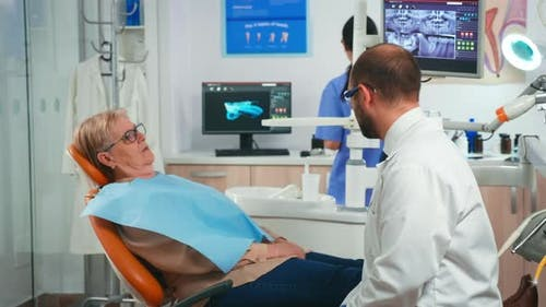 Old Woman Having Medical Treatment at Dentist Office