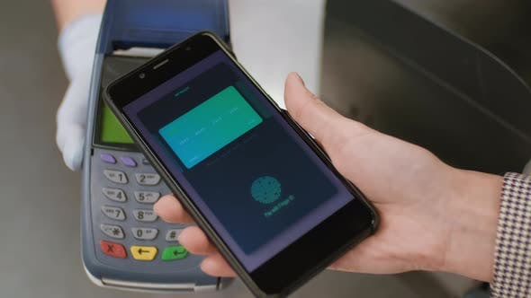 Contactless Payment With Smartphone In Supermarket