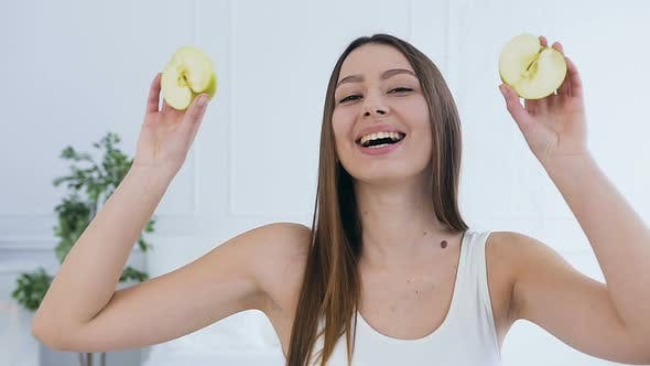 Thumbnail for Beautiful Young Woman with Apple on Eyes