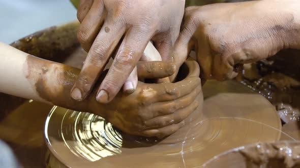 The Potters Wheel and Hands of the Potter.