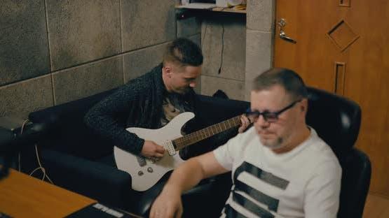 Guitarist Records the Music in a Professional Recording Studio