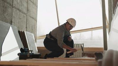 Construction Worker Hammering Down