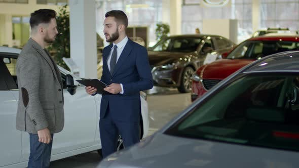 Thumbnail for Auto Salesman Closing Deal with Client