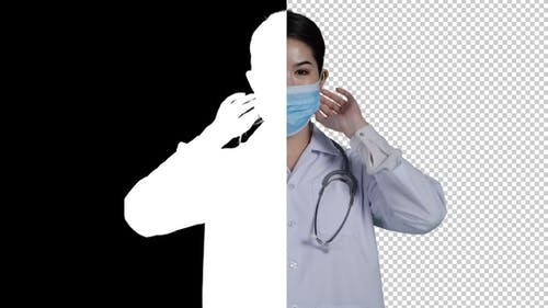 Asian doctor woman wearing mask prevention virus, looking to camera and alpha channel.