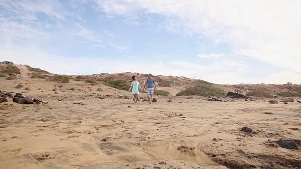 Thumbnail for Walking along sandy beach