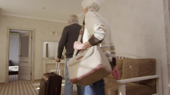Thumbnail for Delighted Mature Caucasian Couple Moving into Hotel Suite