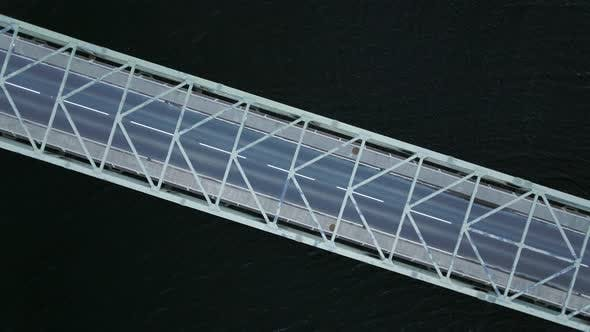 Thumbnail for Bird's Eye View of a Bridge Spanning a Fast Flowing Dark River