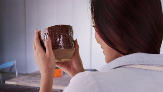 Thumbnail for Japanese woman holding ceramic piece