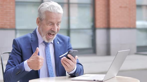 Thumbnail for Old Businessman Excited for Success on Phone