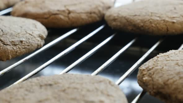 Thumbnail for Close-up female picks homemade cookie  4K 2160p 30fps UltraHD footage -  Hand picking    bread produ