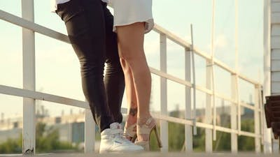 Couple Standing in Port in Summer