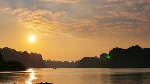 Time lapse: Vietnam Cat Ba bay at sunset with floating fishing boats on sea, cloudscape