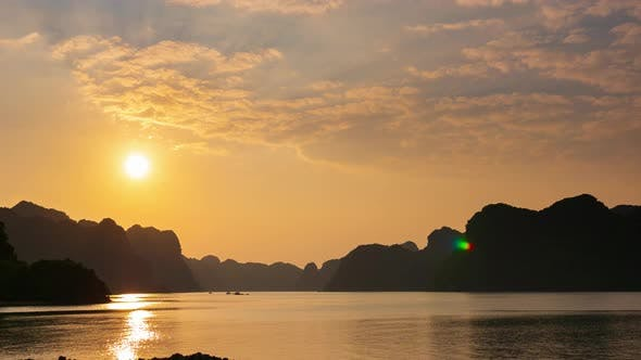 Thumbnail for Time lapse: Vietnam Cat Ba bay at sunset with floating fishing boats on sea, cloudscape