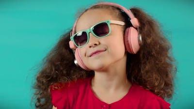 Portrait Little Girl Headphones Listening Music