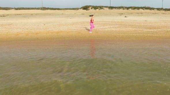 Thumbnail for Young Woman Jog At Sand Sea Coast