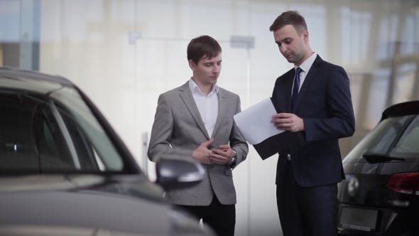 Thumbnail for Sales Manager Convincing a Customer To Buy a Car
