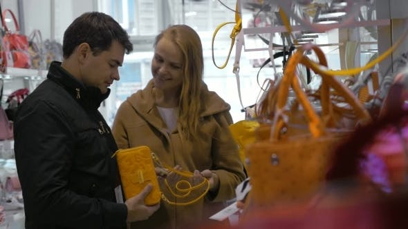 Thumbnail for Family Couple Buying Ladies Handbag In The Store