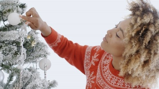 Thumbnail for Attractive African Woman Decorating An Xmas Tree
