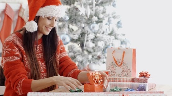 Thumbnail for Young Woman Decorating Her Christmas Gifts