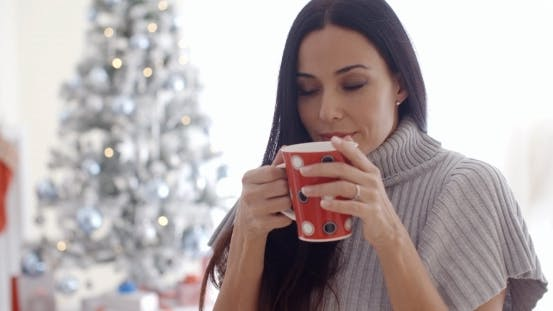 Thumbnail for Woman Enjoying a Cup Of Christmas Coffee