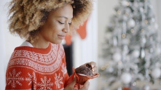 Thumbnail for Young Woman Enjoying a Christmas Treat