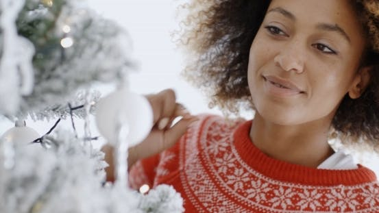 Thumbnail for Pretty Young Woman Decorating a Christmas Tree