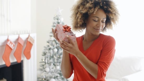 Thumbnail for Blissful Happy Young Woman Holds a Christmas Gift