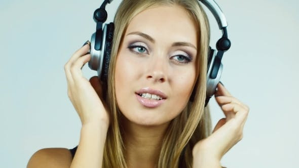Thumbnail for Attractive Blonde Woman Putting On Headphones And