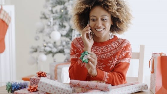 Thumbnail for Young Woman Chatting On Her Mobile At Christmas