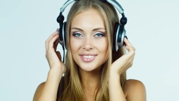 Thumbnail for Blonde Girl Listening To Music On Headphones And
