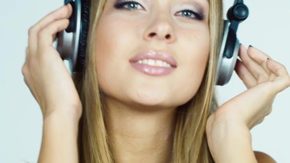 Thumbnail for Blonde Girl Listening To Music On Headphones