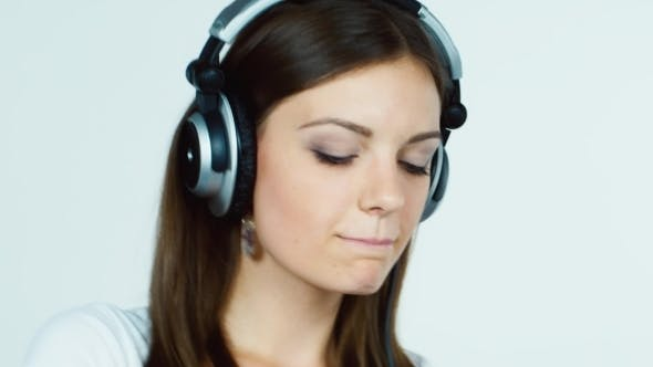 Thumbnail for Dark-Haired Woman Listening To Music On Headphones
