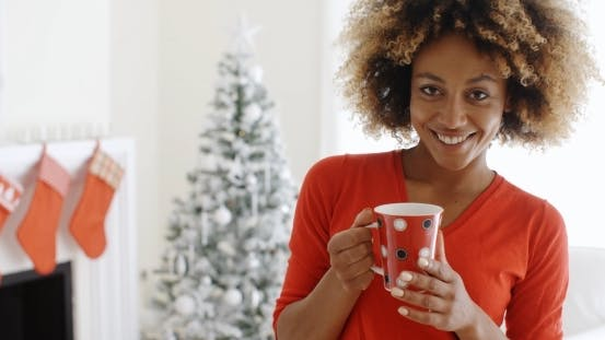 Thumbnail for Pretty Young African Woman Enjoying Coffee
