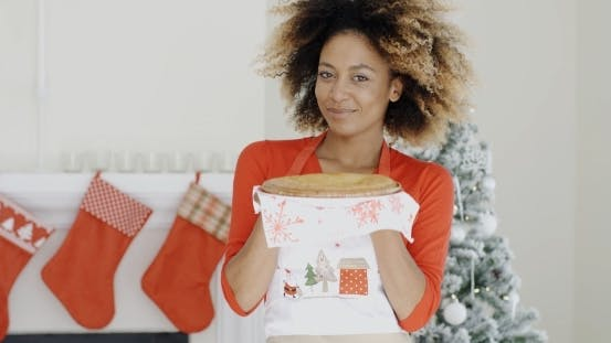 Thumbnail for Happy Young Woman Holding a Christmas Pastry