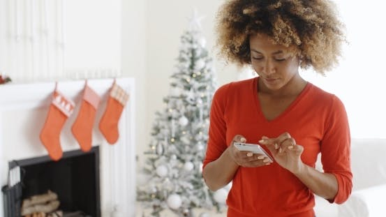 Thumbnail for Young Woman Checking Her Christmas Messages